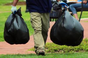 Man Carrying Garbage